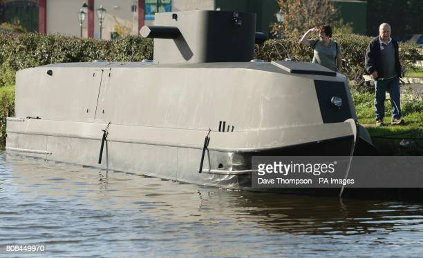 A barge transformed into a German UBoat on the LeedsLiverpool canal in Botonay Bar near Chorley Lancashire