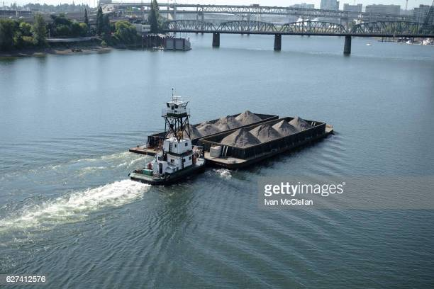 barge transporting sand down the river - willamette river stock photos and pictures