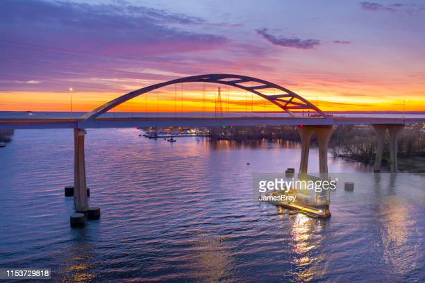 barge under scenic bridge at daybreak - wisconsin stock pictures, royalty-free photos & images