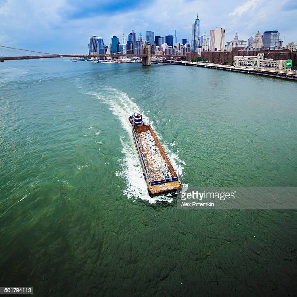barge with garbage at the east river - barge stock photos and pictures