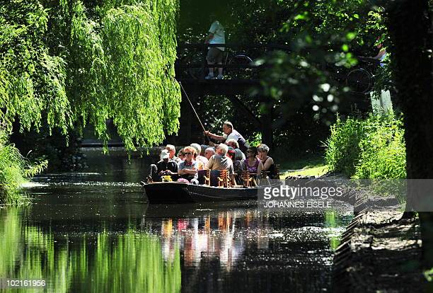 Barge with tourists paddles through the small canals of the eastern German Spreewald region on on June 17, 2010. The Spreewald is a biosphere reserve...