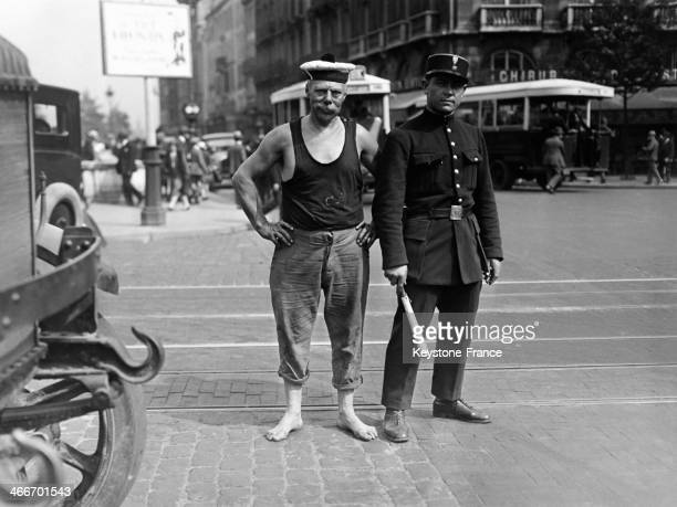 A bargee and a policeman in a street in June 1929 in Paris France