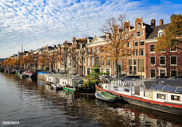 Barges and houses along a canal in Amsterdam