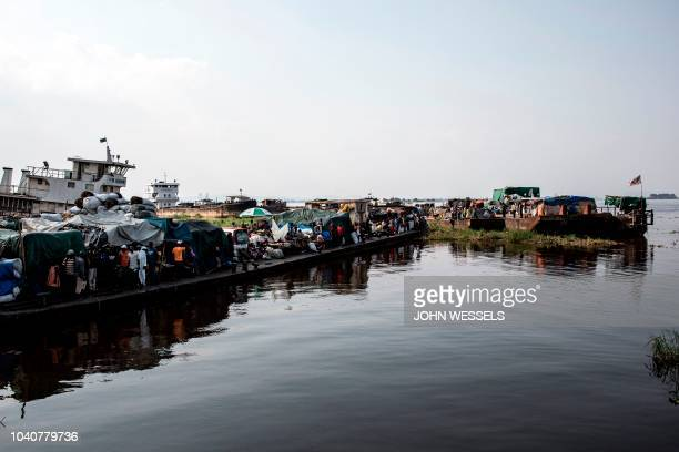 Barges are seen parked at a port along the Congo River on September 25, 2018 in Kinshasa, in the Democratic Republic of the Congo. - Due to the lack...