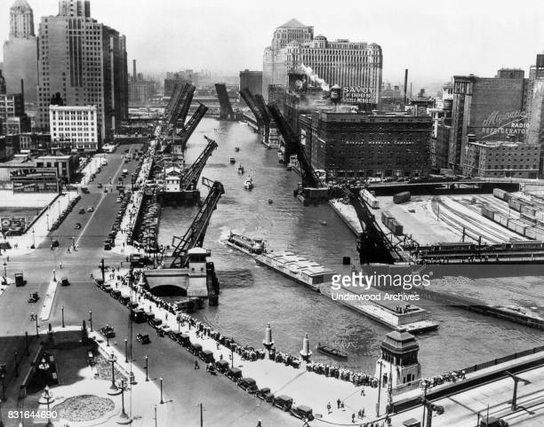 Barges from New Orleans arriving on the Chicago River with Michigan Ave in the lower right corner Chicago Illinois 1933