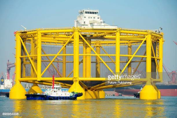 Barges move a semisubmersible smart deepsea salmon farm off the shipyard in east China's Shandong province for a journey to Norway on June 14 2017 in...