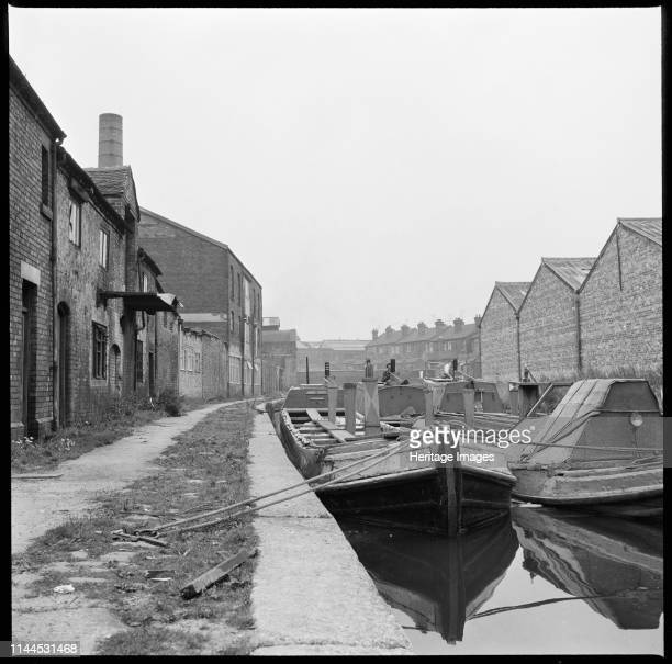 Barges on the Trent & Mersey Canal, Stoke-on-Trent, 1965-1968. Barges moored on the Trent & Mersey Canal opposite WJ Dolby's flint calcinating kiln....