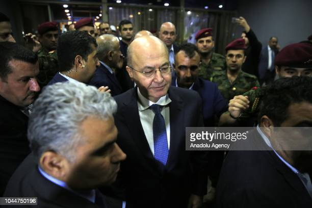 Barham Salih leaves the Iraqi Parliament building after he swore following Iraq's parliament elected him as the new president on Tuesday evening...