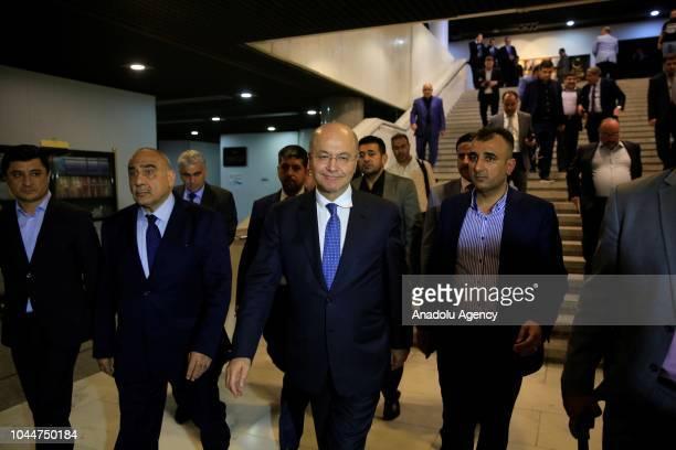 Barham Salih leaves the Iraqi Parliament building with Independent Shia candidate Adil AbdulMahdi after Salih swore following Iraq's parliament...
