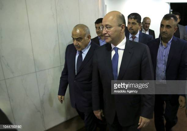 Barham Salih leaves the Iraqi Parliament building with Independent Shia candidate Adil AbdulMahdi after Salih swore following Iraq's parliament...