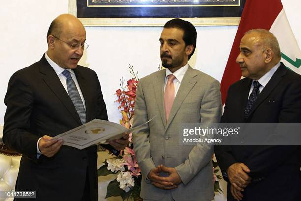 Barham Salih swears in next to Iraqi Parliament Speaker Mohamed alHalbousi after Iraq's parliament elected Salih as the new president on Tuesday...