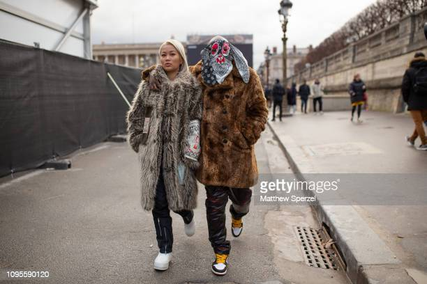 Bari is seen attending Louis Vuitton during Men's Paris Fashion Week AW19 wearing fur coat and face scarf on January 17 2019 in Paris France