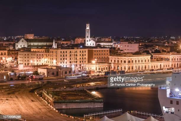 bari skyline illuminated at night in puglia, italy - basilica di san nicola bari foto e immagini stock
