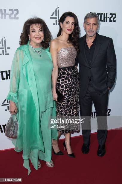 Baria Alamuddin Amal Clooney and George Clooney attend the Catch 22 UK premiere on May 15 2019 in London United Kingdom