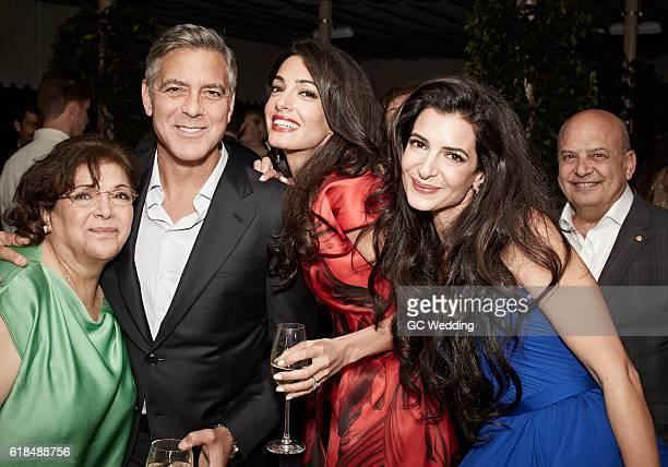 Baria Alamuddin George Clooney Amal Alamuddin sister Tala Alamuddin and Uncle Akram Miknas pose at George Clooney and Amal Alamuddin Wedding on...