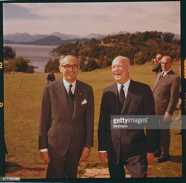 Bariloche, Argentina: President Eisenhower and Argentine President Frondizi enjoy a hearty laugh at Bariloche, where Ike spent some time resting...