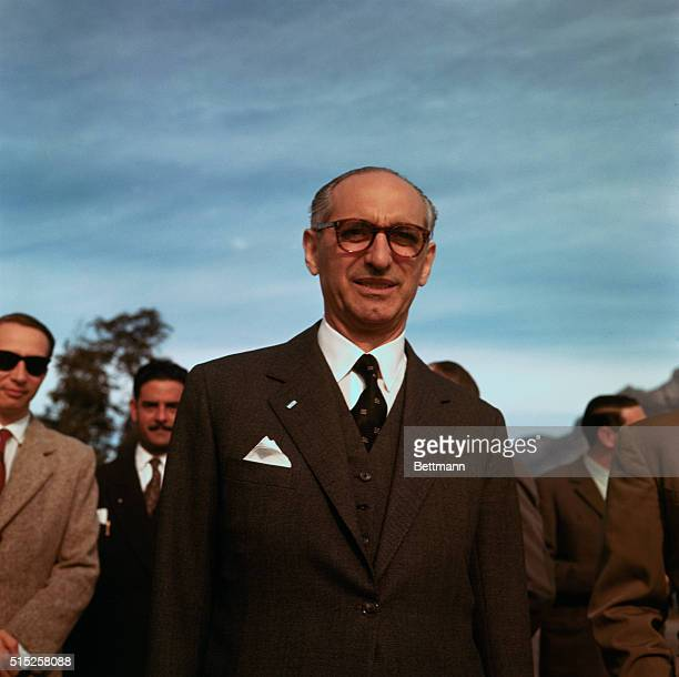 Bariloche, Argentina: President Frondizi of Argentina poses for cameramen at Bariloche, where he was host to President Esienhower during brief rest...