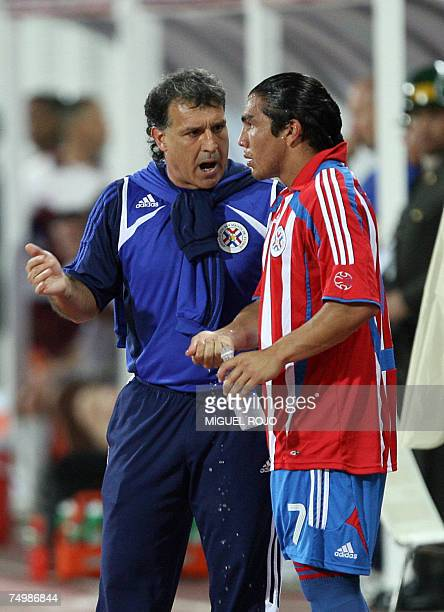 Paraguay's national soccer team coach Gerardo Martino gives instructions to forward Salvador Cabanas during their match against the United States in...
