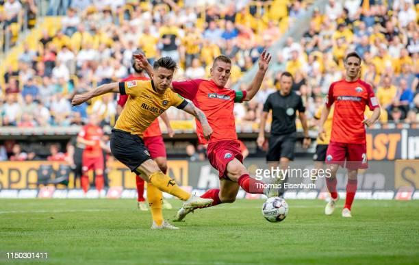 Baris Atik of Dresden scores his team's third goal past Uwe Huenemeier of Paderborn during the Second Bundesliga match between SG Dynamo Dresden and...