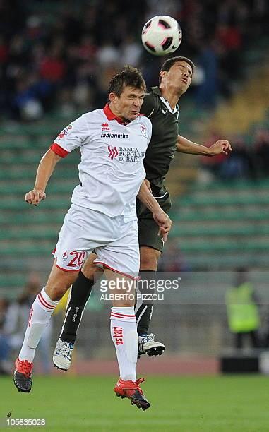 Bari's Bielorussian forward Vitali Kutuzov fights for the ball with Lazio's Brazilian midfielder Anderson Hernanes during an Italian serie A football...