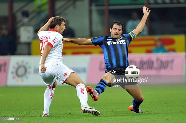 Bari's Bielorussian forward Vitali Kutuzov vies for the ball with Inter Milan Serbian midfielder Dejan Stankovic during the Serie A football match...
