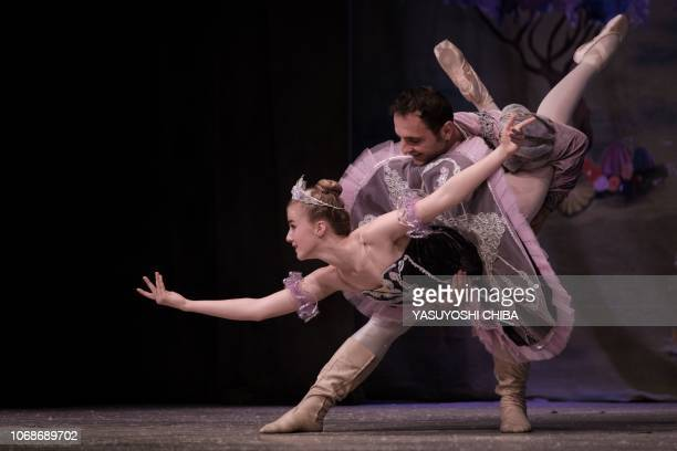 Baris Erhan of the Turkish State Opera and Ballet performs with a dancer of Dance Centre Kenya during the production of the 'Nutcracker' a ballet...
