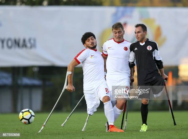 Baris Telli of Turkey in action against Ruslan Shahumyan of Georgia during the European Amputee Football Federation European Championship match...