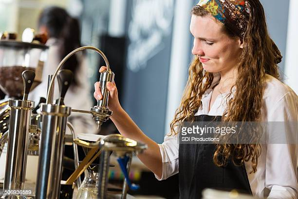 barista creating coffee drink in local shop - coffee drink stock pictures, royalty-free photos & images