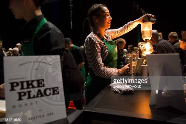Barista Dahzia Orozco brews siphon coffee at the Annual Meeting of Shareholders in Seattle Washington on March 20 2019
