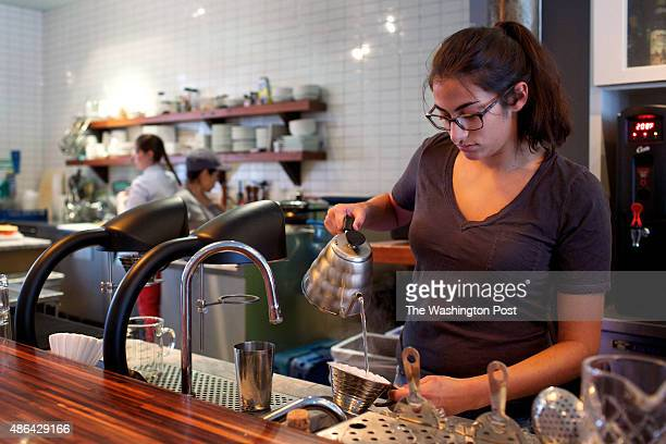 WASHINGTON DC Barista Emily Francis uses the Seraphim pour over coffee brewing system at Slipstream photographed in Washington DC