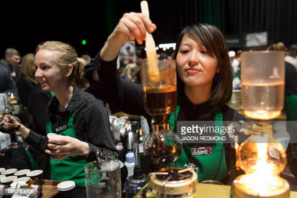 Barista Hiromi Buchanan right brews siphon coffee at the Annual Meeting of Shareholders in Seattle Washington on March 20 2019