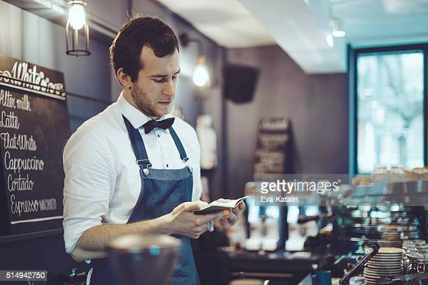 Barista is working in a coffee shop