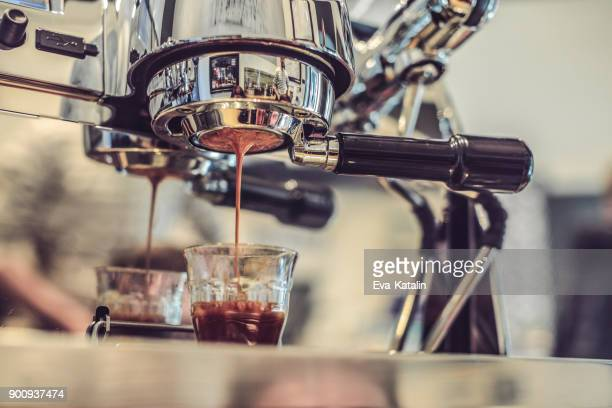 barista is working in a coffee shop - food and drink industry stock photos and pictures