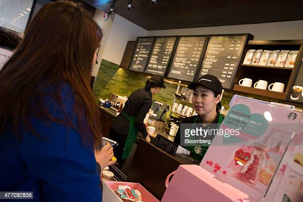 Barista Kim Jung Mi a mother who had left the workforce seven years ago and is now employed by Starbucks Coffee Korea Co under its 'returningmom'...