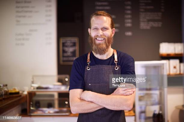 barista looking at camera. - scandinavian descent stock pictures, royalty-free photos & images