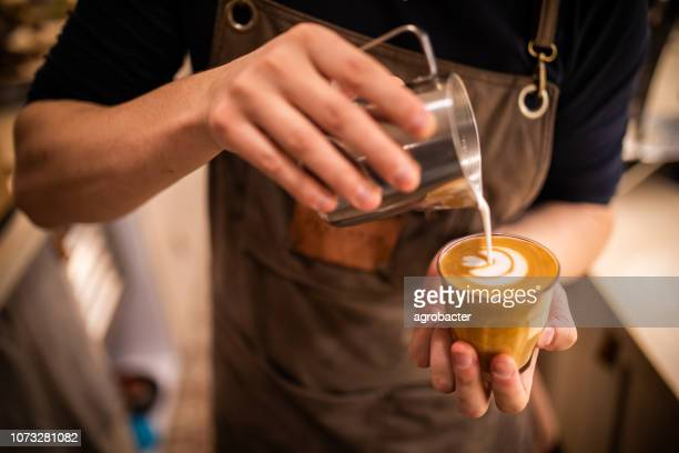 barista make coffee cup latte art - coffee stock photos and pictures