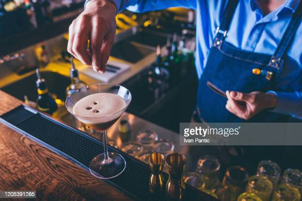 barista making cocktail - espresso stock pictures, royalty-free photos & images
