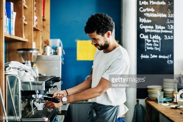 barista making coffee for customers at cafe - wait staff stock pictures, royalty-free photos & images