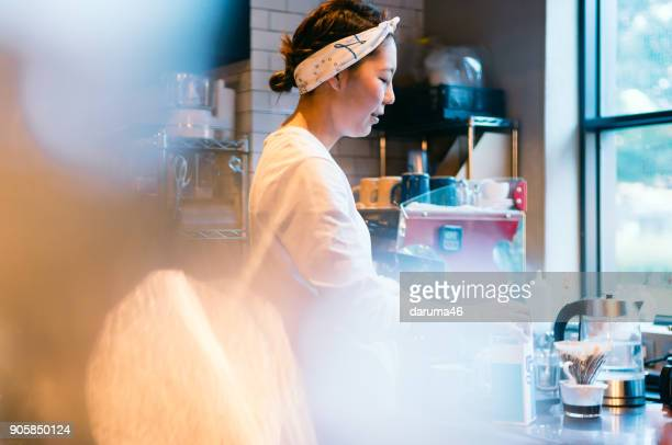 Barista Making Coffee Machine at Cafe Counter