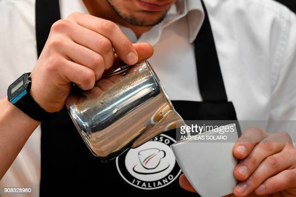 A barista performs latte art skills on a cappuccino during the 39th International trade Show of Artisan Gelato Pastry Bakery and Coffe World in...