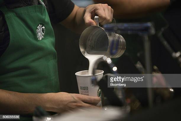 A barista pours frothed milk into a drink inside a Starbucks Corp coffee shop in New York US on Monday Jan 18 2016 Starbucks Corp is scheduled to...