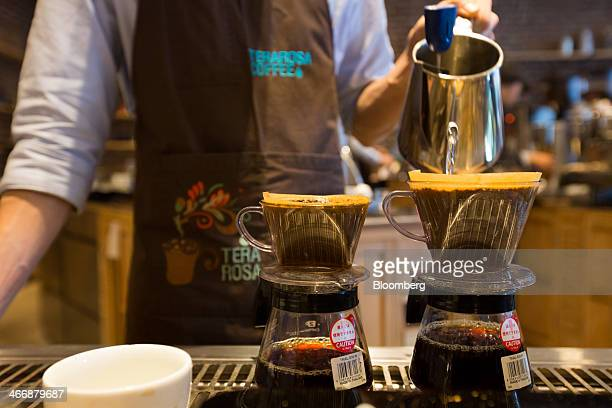 A barista pours hot water into a dripper as a hand drip coffee is prepared at the Terarosa Coffee shop in Seoul South Korea on Tuesday Feb 4 2014...