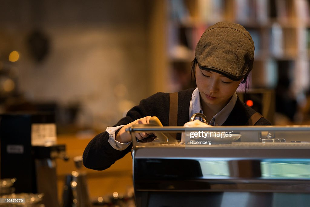 A barista prepares a coffee at the Terarosa Coffee shop in Seoul, South Korea, on Tuesday, Feb. 4, 2014. South Korea is Asias fastest-growing market for arabica coffee, the mild-tasting beans used in premium blends. Photographer: SeongJoon Cho/Bloomberg via Getty Images