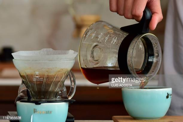 A barista prepares a cup of Geisha Natural coffee variety at the Elida farm in Boquete Panama on January 22 2020 Panamanian coffee Elida Geisha...