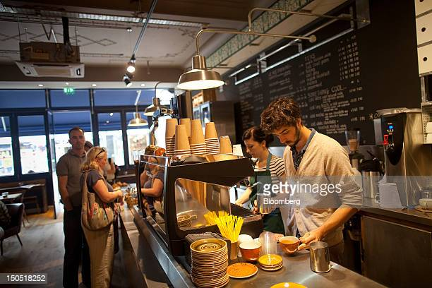 Barista prepares a drink for a customer at a Harris + Hoole coffee store in Amersham, U.K., on Monday, Aug. 20, 2012. Harris + Hoole, an artisanal...