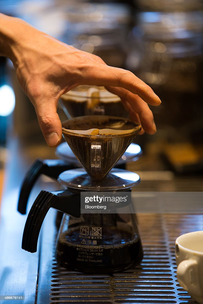 A barista prepares a hand drip coffee at the Terarosa Coffee shop in Seoul, South Korea, on Tuesday, Feb. 4, 2014. South Korea is Asias fastest-growing market for arabica coffee, the mild-tasting beans used in premium blends. Photographer: SeongJoon Cho/Bloomberg via Getty Images