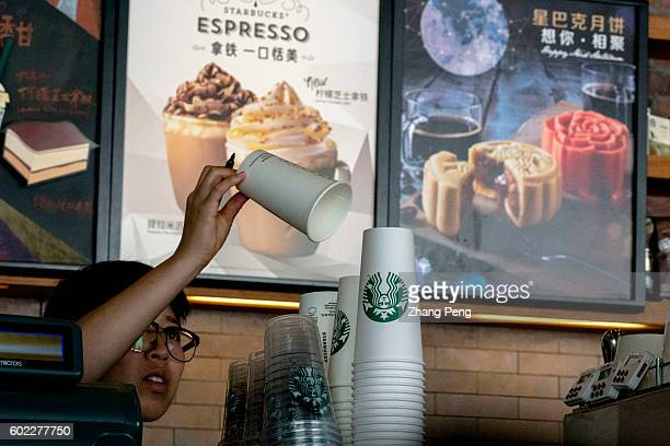 Barista prepares a paper cup in a Starbucks coffee shop During the third quarter 2016 Starbucks China had $7682 million in sales a growth of 17%...