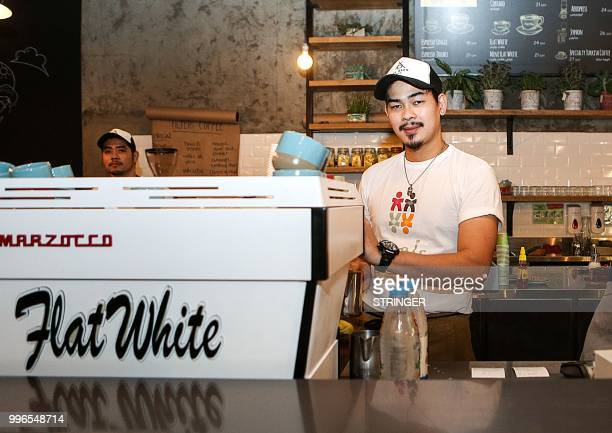 A barista prepares coffee at the 'Flat White' cafe in the Qatari capital Doha's Tawar Mall on June 8 2018 Tawar Mall looks like any of Qatar's...