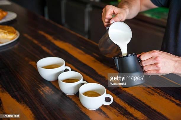 Barista preparing cappuccino in a cafe