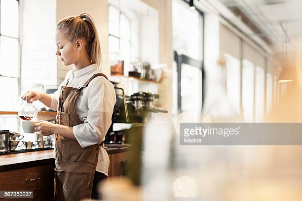 Barista preparing coffee at cafe counter